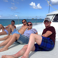Friends relax on the catamaran