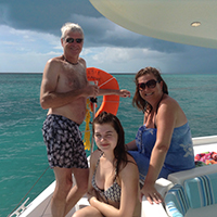 family enjoys afternoon sailing cruise